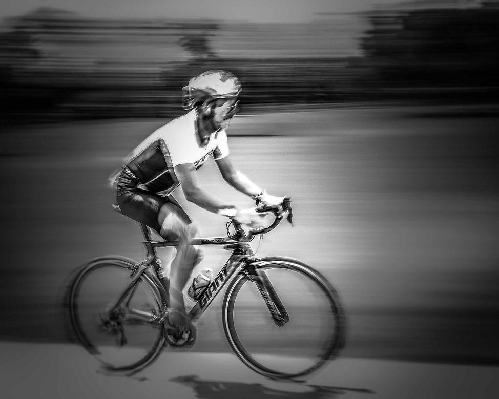 Bicycle racer on a Giant bicycle racing at blurred speed
