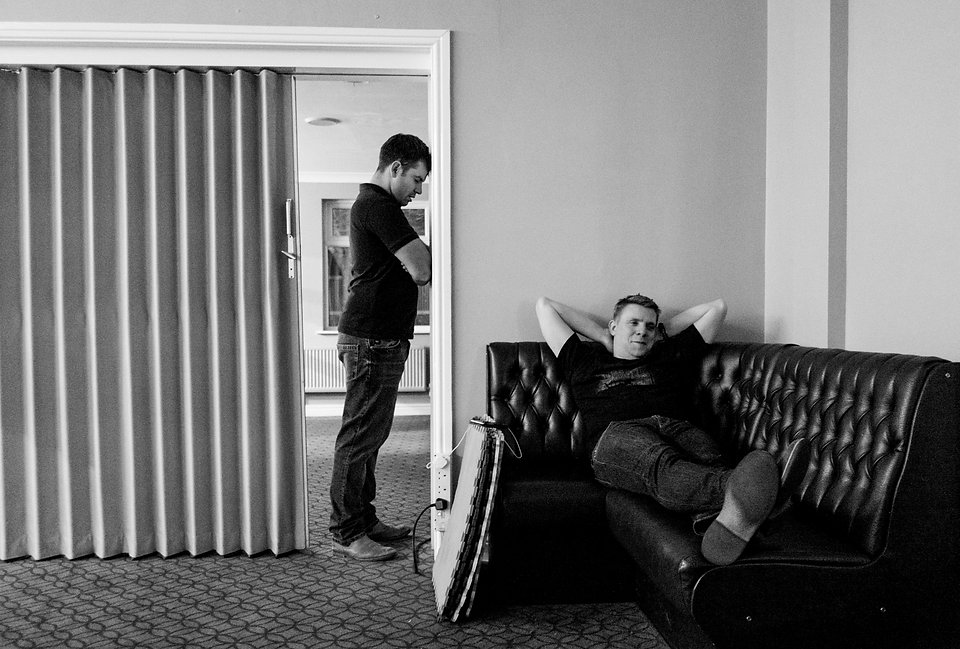 Two comedians Michael Fabbri and Joe Rowntree backstage at a comedy club in the UK. Michael has finished his comedy show and Joe is waiting to go on stage