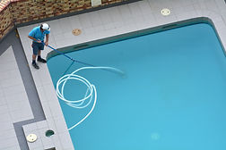 Aerial view of a pool cleaner cleaning a
