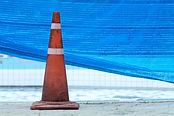 traffic cone near swimming pool repairin