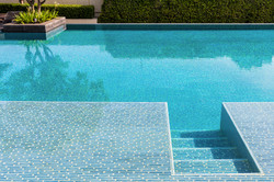 Swimming pool made by mosaic tiles with