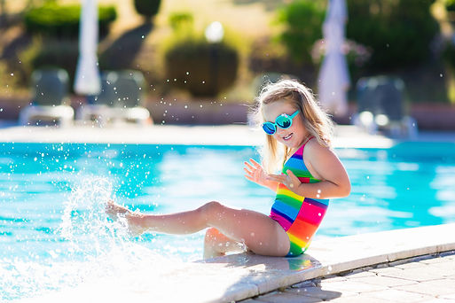 Little girl playing in outdoor swimming