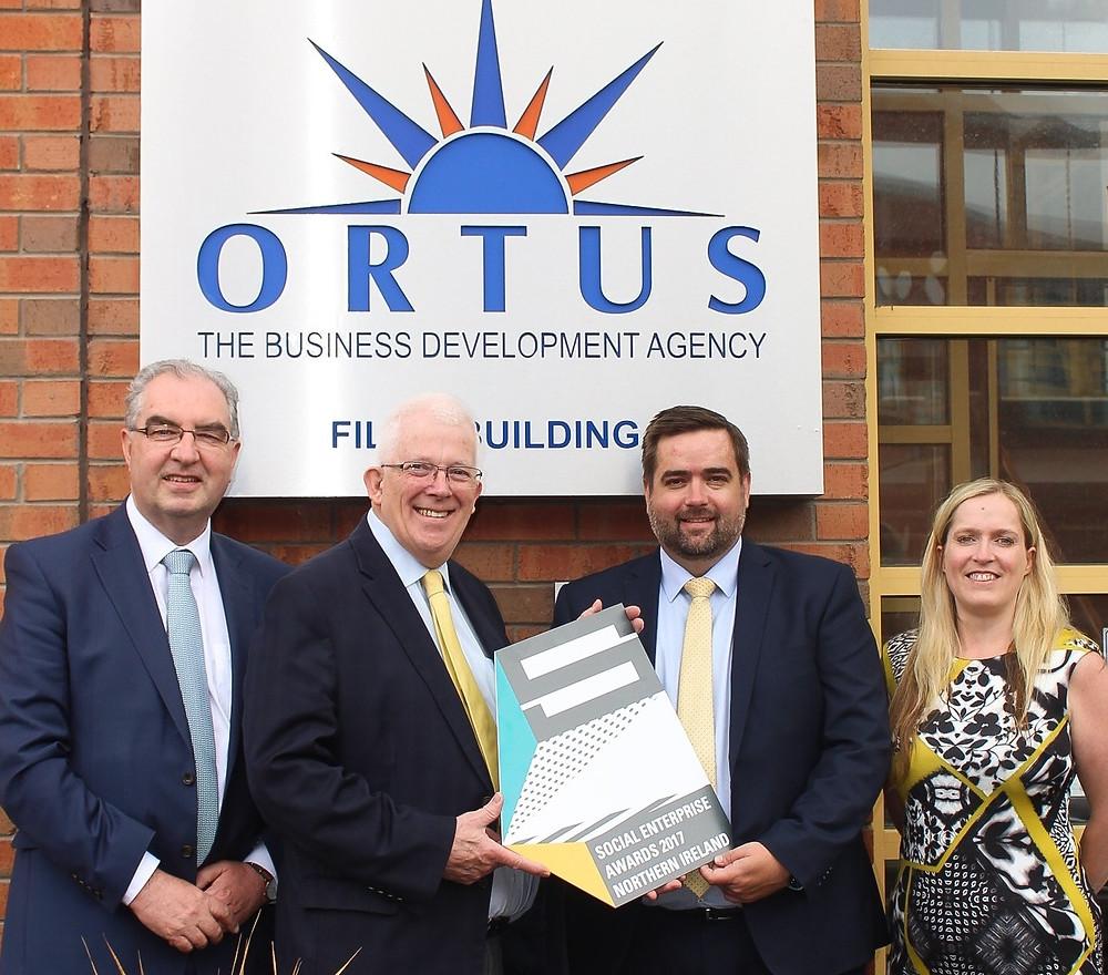 Colin Jess, Social Enterprise Director (left), Stewart Dickson MLA, (middle left), Seamus O'Prey, The Ortus Group CEO (middle right), and Amanda Johnston, Social Enterprise NI (right)