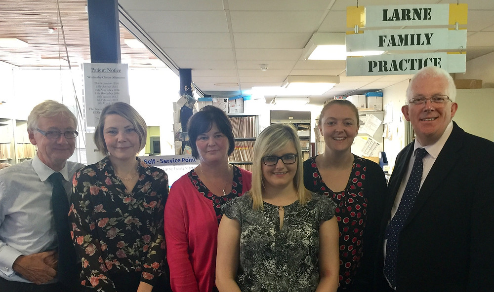 Dr Peter Howie (left) with the Larne Family Practice staff and Stewart Dickson MLA (right)