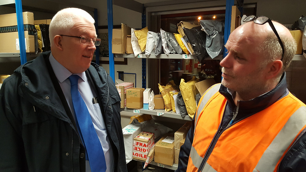 Stewart Dickson MLA with Carrickfergus Royal Mail Sorting Office Manager Eric Earley during his visit to see the Staff preparing for delivery of Xmas mail