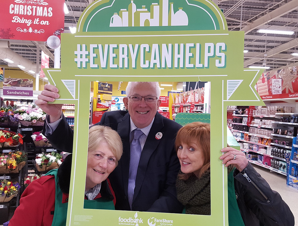 Stewart Dickson MLA supporting the Carricfergus Foodbank collection at TESCO with Elizabeth Nicholl (Left) Jill McIlreany Foodbank volunteers