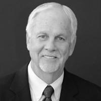 black and white headshot of Dr. James (Bo) Reagan