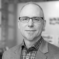 black and white headshot of Tim Kelsey