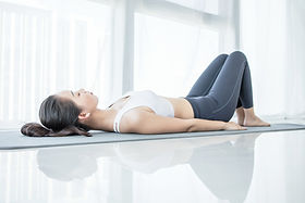 Woman laying down for starting exercising isolated on white background.jpg