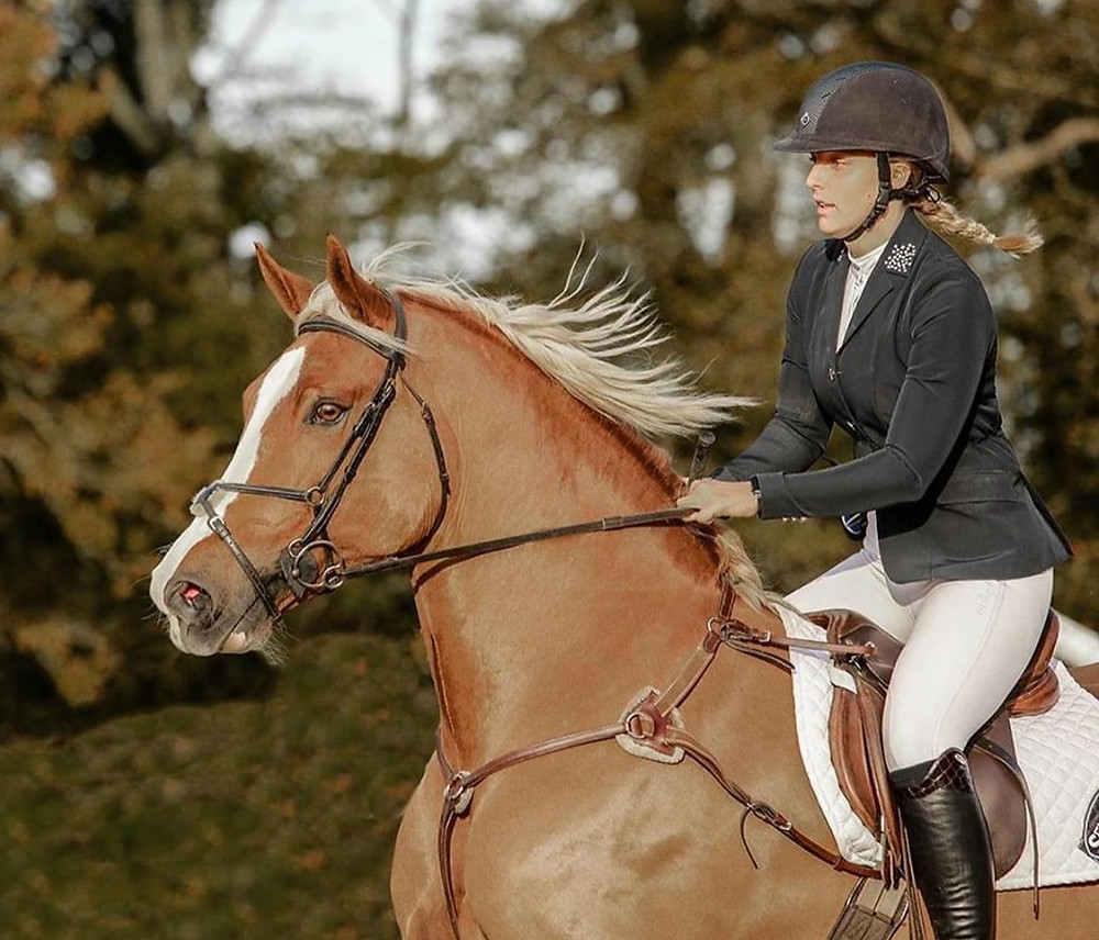 girl riding her horse