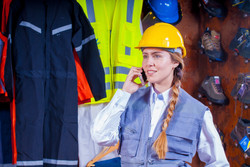 woman-in-gray-vest-with-yellow-hard-hat-