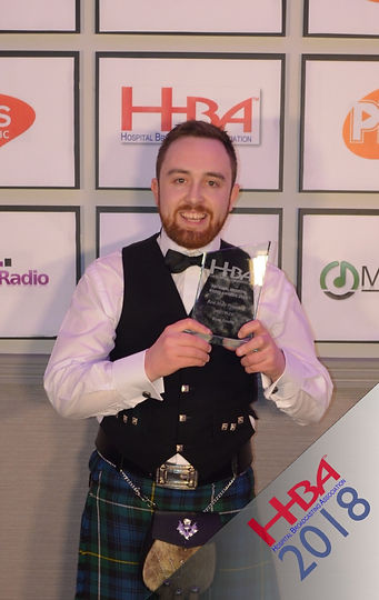 Ross picking up bronze award for male presenter.jpeg