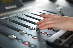 radio-host-using-music-mixer-in-studio-P27HY9W.jpg