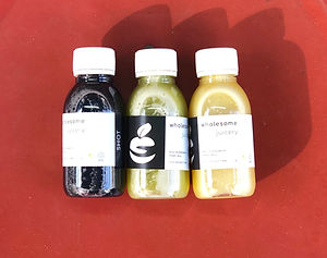 juice delivery uk - wholesome juicery - wellness wellbeing shots - ginger shot - turmeric shot - charcoal shot