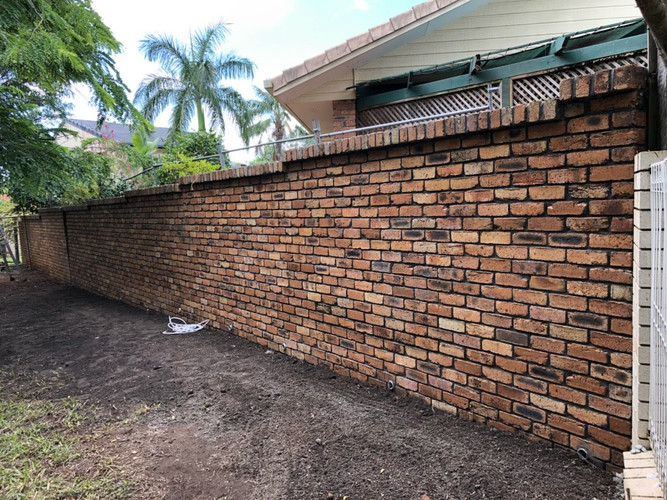 Brick fence repairs - after
