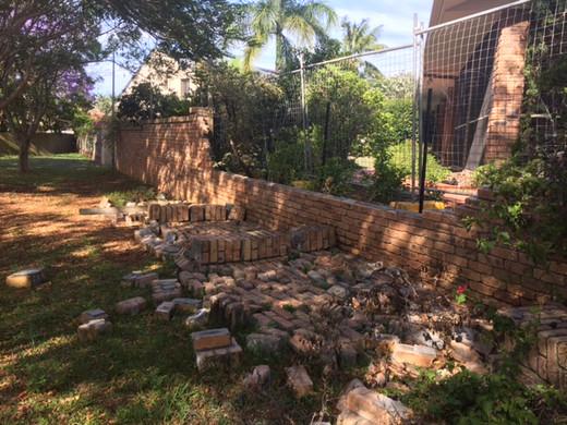 Brick fence repairs - before