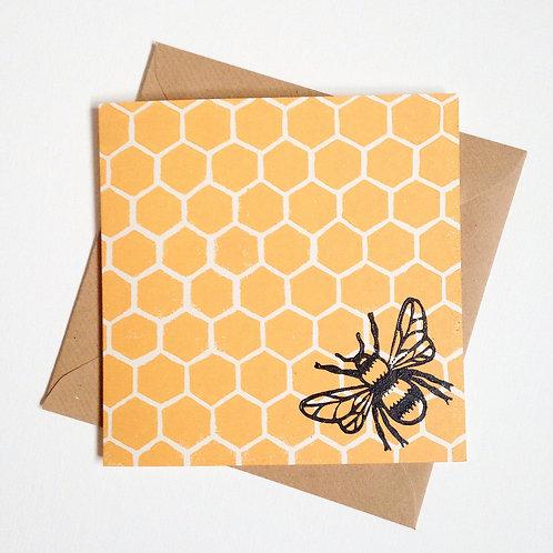 Bee on honey greeting card