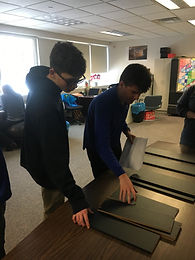 Students building a bookcase