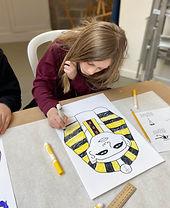 Student creating Egyptian mask
