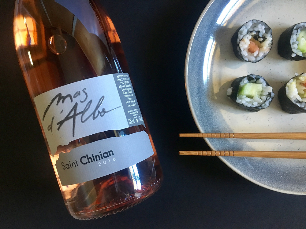 Bottle of Mas d'Albo rosé Saint Chinian cucumber and avocado salmon makis