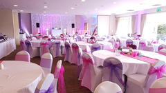 Pink and Purple Sashes and White Chair Covers