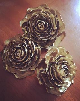 Gold sprayed rose cones