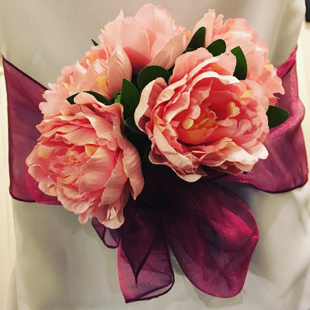 Pink organza sash with pink flowers and White Chair Covers