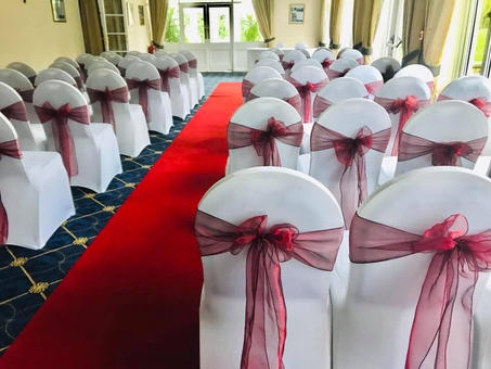 Christmas Red organza sash and White Chair Covers