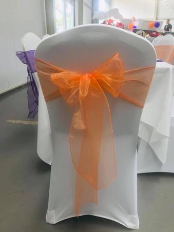 Orange organza sash and White Chair Covers