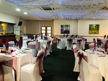 Maroon sashes and White Chair Covers