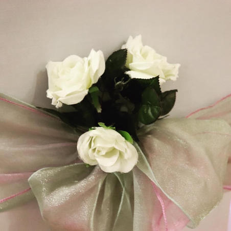 Sage green sashes with satin rose flowers and White Chair Covers