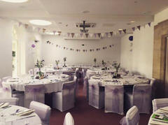 Lilac Organza Sashes and White Chair Covers