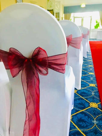 Christmas Red sashes and White Chair Covers