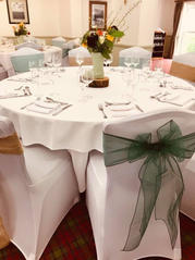 Dark green and hessian sashes and White Chair Covers