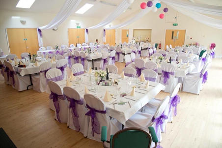 Cadbury purple organza sash and White Chair Covers