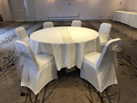 Silver Sashes and White Chair Covers