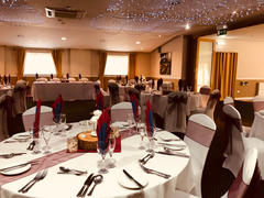 Dark Red sashes and White Chair Covers