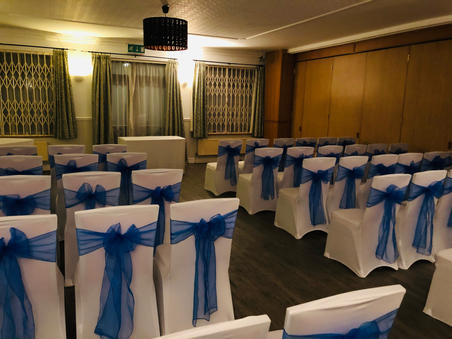 Royal Blue Sashes and White Chair Covers