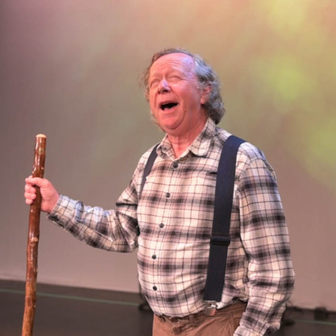 Grandfather sets the scene at the beginning of the show