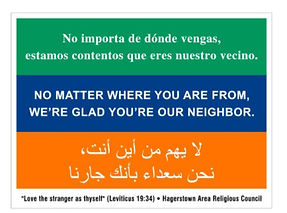 Lawn sign welcoming Americans from all nations