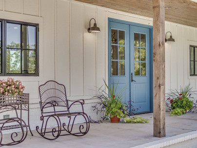 Front porch with a blue door