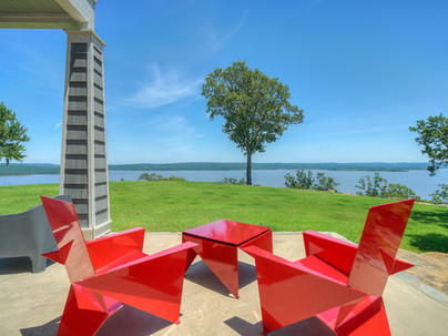 Red patio chairs overlooking the lake