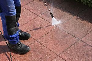 Caretaker with high-pressure cleaner.jpg