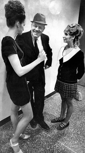 Tavern owner Leonard Glancy is flanked by dancers Susanne Haines (left) and Sheila Brendendson. The three stood trial during 1969 indecency trial