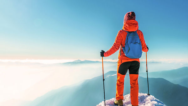 Woman hiker successful on mountain peak
