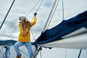 Young strong woman sailing the boat.jpg
