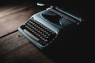vintage-typewriter-in-shadow.jpg