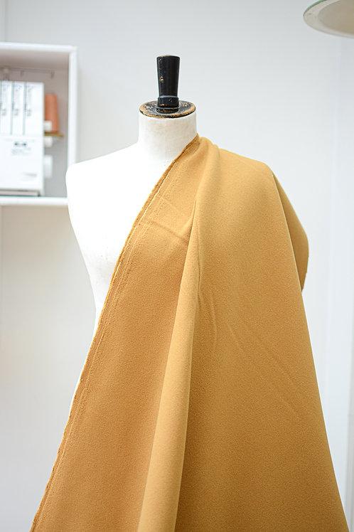 Polyester uni geel/beige