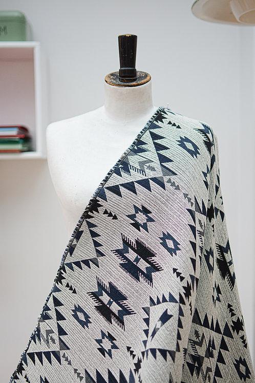 Gebreide stof met aztekenprint grijs