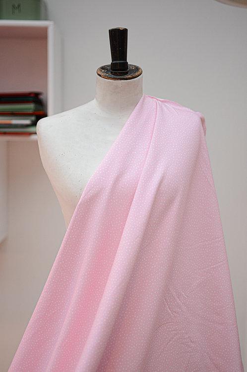 Tricot roze met witte stippen